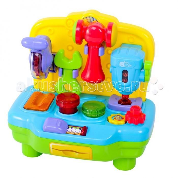 Playgo Моя первая мастерскаяМоя первая мастерскаяМастерская Playgo Play 2449 - яркий разноцветный набор инструментов с веселыми мелодиями.   Особенности: На гладкой поверхности столика расположены линейка, две кнопки, термометр и много других вещей.  На маленькой стеночке закреплены инструменты,такие как циркулярная пила, молоточки с прорезиненной поверхностью, дрель и гаечный ключ.  Игрушка изготовлена из высококачественного пластика. Отремонтировать любимую игрушку теперь не проблема! Со световым и звуковым эффектами. Работает от 2 батареек типа «АА»<br>