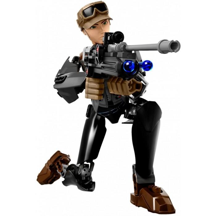 Конструктор Lego Star Wars Сержант Джин ЭрсоStar Wars Сержант Джин ЭрсоLego Star Wars Сержант Джин Эрсо - еще одна новая модель из серии ультра-фигур линейки «Star Wars» от компании Лего. Это модель героини девушки-воина, бывшей преступницы, которая жила во времена Имперской войны и стала одной из команды сопротивления – Джин Эрсо. Так же как и K-2S0 была отправлена на «Звезду смерти» с миссией по похищению чертежей. В готовом виде игрушка оснащена бластером с пружинным механизмом, стоит только его зарядить, взвести курок и можно стрелять на поражении из этого супер-оружия.    Потом необходимо вооружиться дубинкой, повернуть колесико и Джэйн начнет боевое вращение руками! Ну вот, теперь сержант Эрсо готова к бою, можно смело атаковать имперцев, чтобы решить исход сражения в свою пользу! Высота всех фигур в этой модели 30-32 см, линейка отличается не только размером фигур, но и типом деталей. Впервые данная серия увидела мир в 2015 году. Это отличное дополнение в коллекцию для поклонников Звездных войн любого возраста, на данный момент в этой подсерии выпущено 14 разных моделей.<br>