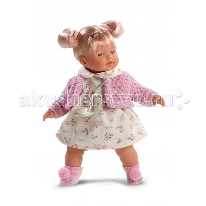 Llorens Кукла Ариана 33 см со звукомКукла Ариана 33 см со звукомLlorens Кукла Ариана 33 см со звуком. Кукла из ПВХ с мягконабивным туловищем с наполнителем из синтетического волокна. Кукла умеет плакать и говорить мама, папа. Одета в светлое платье, розовую кофточку, носочки.   К кукле прилагается соска. Если вынуть соску изо рта куклы, то она начинает плакать. Для того чтобы она перестала плакать - поместите соску в рот куклы. Глазки у куклы не закрываются. Упакована в подарочную упаковку.<br>