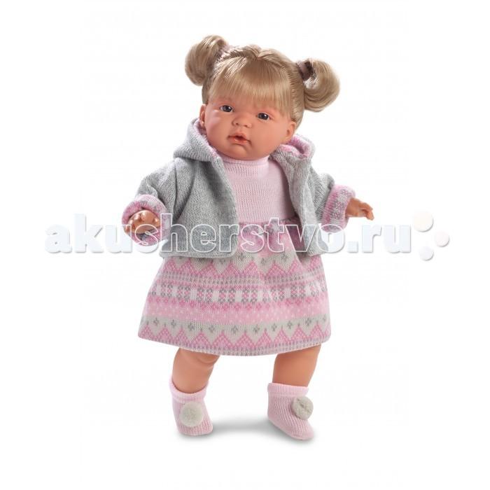 Llorens Кукла Рут 38 смКукла Рут 38 смLlorens Кукла Рут 38 см. Кукла из ПВХ с мягконабивным туловищем с наполнителем из синтетического волокна. Кукла умеет плакать и говорить мама, папа. Одета в белое платье, розовую кофточку, носочки.   К кукле прилагается соска. Если вынуть соску изо рта куклы, то она начинает плакать. Для того чтобы она перестала плакать - поместите соску в рот куклы. Глазки у куклы не закрываются. На личике имеются веснушки. Волосы прошиты по всей голове. Упакована в подарочную упаковку.<br>