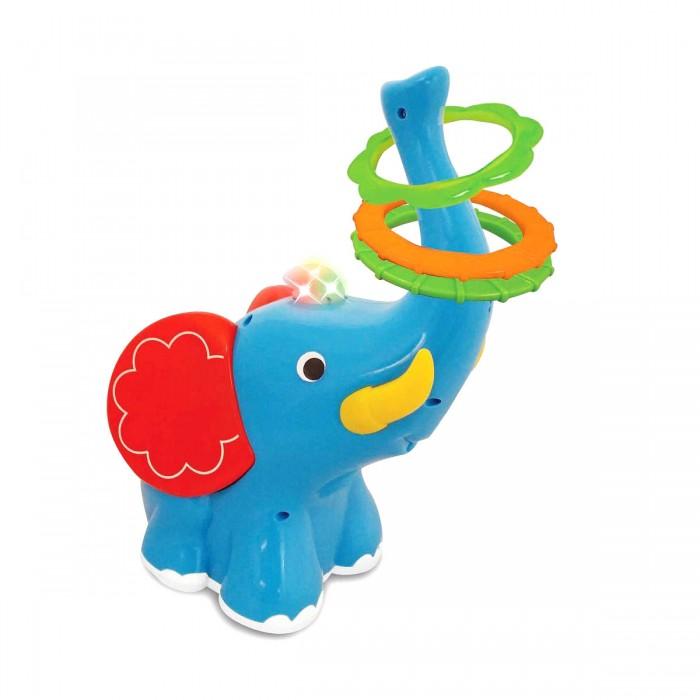Развивающая игрушка Kiddieland Слон-кольцебросСлон-кольцебросРазвивающая игрушка Kiddieland Слон-кольцеброс со световым и звуковыми эффектами. Хобот слона задран вверх и на него надеты разноцветные кольца. Необходимо их снять и метать кольца на удобном для ребенка расстоянии, чтобы они попали на хобот движущегося слоненка.   Слон двигается  вперед, поворачивается и двигается назад.  В комплекте 3 кольца.<br>