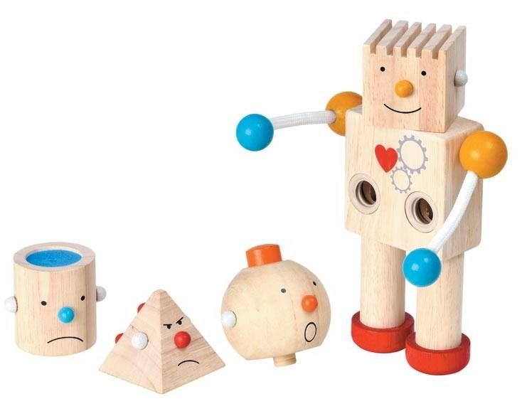 Деревянная игрушка Plan Toys конструктор Роботконструктор РоботДеревянный конструктор Робот с двигающимися руками и сменными головами придется по душе любителю фантастических героев и игрушек-конструкторов.  В комплект входят 4 деревянные сменные головы различного геометрического вида с разными настроениями для робота.   Только от воображения ребенка зависит, как будет выглядеть робот в зависимости от сюжета игры, будет ли он улыбаться или сердиться, радоваться или грустить.   Игра с роботом развивает у ребенка воображение, мелкую моторику, логику и зрительное восприятие.  Все детали выполнены из каучукового дерева с использованием нетоксичных красок.  Размер игрушки: 6,6 х 12 х 20 см. Для детей от 3 лет<br>