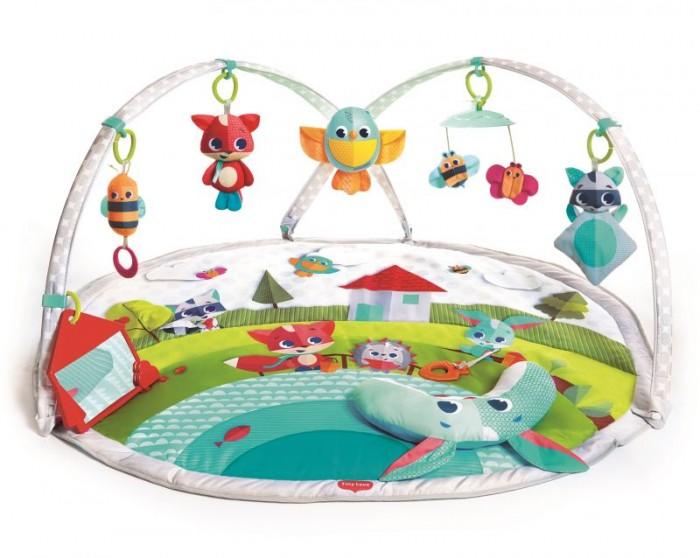Развивающий коврик Tiny Love Солнечная полянкаСолнечная полянкаРазвивающий коврик Tiny Love Солнечная полянка предназначен для детей до года и будет интересен как девочкам, так и мальчикам.  Напольный мягкий коврик с красочными изображениями, пищалками и разными по фактуре вставками поощряет малыша к играм на животе и ползанию.  На дугах расположены разноцветные игрушки-подвески: музыкальное солнышко,  безопасное зеркальце,  черепашка-погремушка,  вибрирующая лягушка  листочки-прорезыватели.  Многофункциональный безопасный коврик развивает мелкую моторику, слух, зрение и тактильное восприятие ребенка.<br>