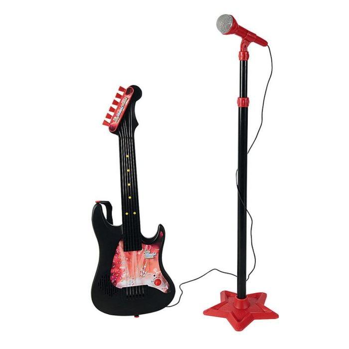 Музыкальная игрушка Simba Гитара и микрофонГитара и микрофонМузыкальная игрушка Simba Гитара и микрофон, в который входят эффектная чёрно-красная гитара и стойка с микрофоном. Маленький виртуоз ещё больше полюбит выступать на публике и сможет проявить все свои артистические способности, а в вашем доме будут проходить потрясающие музыкальные концерты.   К тому же гитара разовьёт у малыша мелкую моторику, координацию движений и тактильные ощущения. В занимательных сюжетных играх смогут участвовать и друзья вашего артиста.   В комплекте: Гитара Микрофон Стойка  Размеры: стойка регулируется от 70 до 125 см<br>