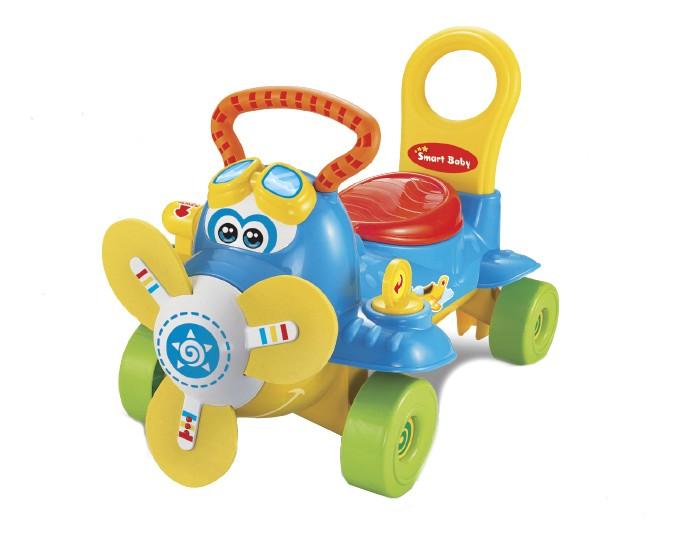 Ходунки Smart Baby Самолет каталкаСамолет каталкаХодунки Smart Baby Самолет каталка выполнены из высококачественной пластмассы яркой и привлекательной расцветки. Игрушка предназначена и для дома, и для улицы.   Ходунки Smart Baby Самолет каталка обладают звуковыми и световыми эффектами. Имитация звуков настоящего самолета, светящийся и вращающийся пропеллер непременно привлекут Вашего малыша. Пропеллер изготовлен из мягких материалов, безопасен при катании.    Ходунки Smart Baby Самолет каталка тренируют мышцы ног, помогают Вашему малышу делать первые шаги. Развивают вестибулярный аппарат, моторику, чувство равновесия, ловкость и координацию движений.  Для работы требуется 3 батарейки типа АА.<br>