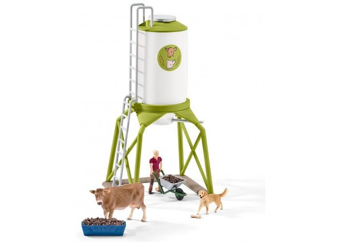 Schleich Набор корма с животнымиНабор корма с животнымиSchleich Набор корма с животными поможет сделать игру вашего ребенка еще более увлекательной, а жизнь на игрушечной ферме полноценной и удобной.   Особенности: Для того, чтобы животные на ферме чувствовали себя хорошо и были здоровы, фермер запас свежий и вкусный корм. Он поместил его в специальный силос для защиты от полевых мышек и других грызунов. Повернув рычаг в нижней части силоса корм можно высыпать прямо в кормушку!  Все составляющие из набора выполнены из качественного каучукового пластика с мельчайшей прорисовкой деталей. Игровые элементы имеют реалистичный внешний вид, приятны на ощупь и позволяют детям играть с большим удовольствия.  Набор продается в картонной коробке.  В процессе игр с миниатюрными фигурками у ребенка прекрасно развивается мелкая моторика, стимулируется развитие речи, логическое мышление, ребенок знакомится с окружающим миром.  В комплекте: Силос Фермер с тачкой Корова Собака Корыто Косточка Корм.<br>