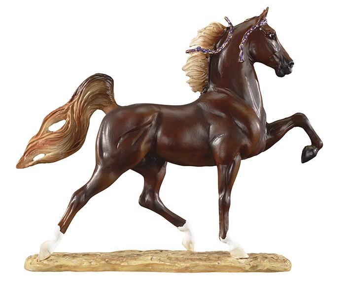Breyer Лошадь Американской верховой породыЛошадь Американской верховой породыМодель лошади американской верховой породы, или сэддлбреда, из серии Породы мира создана мастерами компании Breyer.   На данный момент продукты компании Breyer являются самыми реалистичными копиями лошадей благодаря точности линий, проработке мелких деталей и ручной росписи. Все это позволяет сделать каждую лошадь особенной и абсолютно не похожей на других.   Скульптура лошади Американской верховой породы на подставке станет настоящим подарком для всех коллекционеров и поклонников Breyer.  Данная порода появилась в XIX веке в американском штате Кентукки, за что и получила свое название Kentucky Saddlebred (Кентуккская верховая), однако после популяризации и распространения по всей территории Америки ее переименовали в просто американскую верховую. Поскольку американская верховая активно использовалась для дальних переездов и осмотров плантаций, в породе культивировались наиболее удобные для всадника аллюры: шаг, рысь и галоп, а также иноходь и рэк, уникальные для этой породы лошадей и особенно удобные для всадника при длительном нахождении в седле. За эту свою особенность американских верховых еще называли пятиаллюрными. Из-за эффектного внешнего вида- правильное телосложение, прямой профиль, высокий выход шеи- и красивого хода - кони высоко поднимают ноги при движении, будто приплясывая, в настоящее время американских верховых активно используют как шоу-лошадь, выступая на них на ринге верхом, либо запрягая в небольшие легкие экипажи.   Размер лошади Д х В - 14.6 х 12.7 см  Лошадь упакована в подарочную закрытую коробку. Изготовлена из скульптурного пластика, абсолютно безопасна в использовании.<br>
