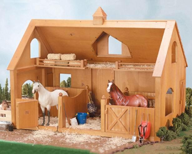 Breyer Деревянная конюшня для лошадей ДелюксДеревянная конюшня для лошадей ДелюксПомимо игровых и коллекционных моделей лошадей Breyer разработали целый ряд разнообразных аксессуаров, позволяющих сделать игру еще более интересной и увлекательной, и создавать целые сценки из жизни любимых лошадок на полке у ребенка.   Создать собственное хозяйство Вам поможет роскошная деревянная конюшня от Breyer. В ней можно спокойно разместить до 3 лошадей серии Traditional или Classic. Конюшня включает 2 просторных денника с кормушками, открываемые двери и окна, верхний этаж для хранения сена или хозяйственных принадлежностей. На фасаде установлен специальный механизм для поднятия предметов на второй этаж. Открытая задняя стенка обеспечивает свободный доступ к любой части конюшни.  Конюшня очень удобна как для игры, так и в качестве декораций для демонстрации коллекции.    Выполнена из дерева.   Аксессуары и лошади продаются отдельно, так же дополнительно можно приобрести фигурки людей и хозяйственный инвентарь.   Все изготовлено из высококачественных материалов, экологично и абсолютно безопасно.   Масштаб 1:9   Размер конюшни Д х В х Ш - 77.5 см х 53.4 см х 47 см<br>