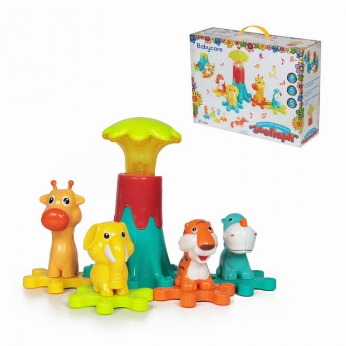 Фото Музыкальные игрушки Baby Care Конструктор-каруселька Зоопарк