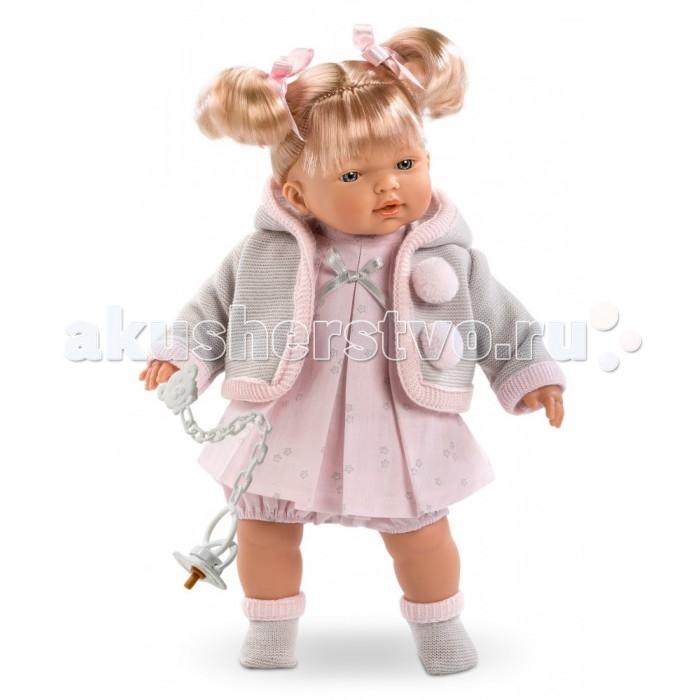 Llorens Кукла Роберта 33 смКукла Роберта 33 смКукла Llorens Роберта 33 см - реалистичная куколка с ямочками и складочками на ручках и ножках.  Эта малышка по имени Роберта очарует свою хозяйку голубыми глазками, пухлыми губками и правдоподобными волосами светлого цвета, заплетёнными в хвостики. Кукла одета в розовое платьице и шортики, вязаную кофточку с капюшоном и помпонами, а также в тёплые мягкие носочки.    Особенности:  Личико подробно и детально проработано, черты лица тонкие и аккуратные.  Кукла имеет мягконабивное тело, а голова ручки и ножки изготовлены из приятного на ощупь винила с запахом ванили.  Подвижные части тела позволяют легко переодевать куколку и придавать ей различные игровые позы.  При нажатии на животик малыш начинает плакать и звать маму и папу.   Волосы отличаются густотой, шелковистостью и блеском, при расчесывании они не выпадают и не ломаются.  Волосы прошиты по всей голове. Высота: 33 см<br>