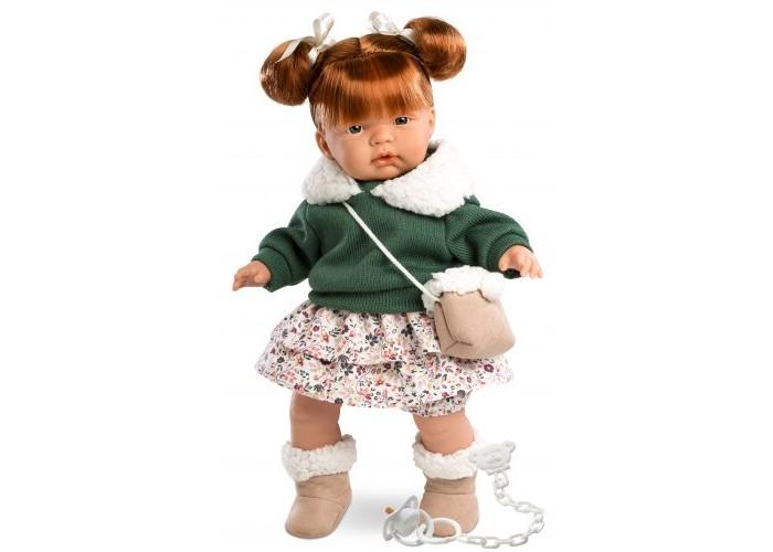 Llorens Кукла Кейт 38 смКукла Кейт 38 смКукла Llorens Кейт 38 см - реалистичная куколка с ямочками и складочками на ручках и ножках.  Кукла представляет собой малышку такой возрастной группы, когда дети уже начинают самостоятельно ходить. Ее внешность проработана до мельчайших деталей и великолепно исполнена. У нее пропорциональное тело, соответствующее ребенку данного возраста. У девочки открытый взгляд, курносый носик и пухлые губки. Ее рыжие волосы собраны в два аккуратных высоких хвостика.    Особенности:  Личико подробно и детально проработано, черты лица тонкие и аккуратные.  Кукла имеет мягконабивное тело, а голова ручки и ножки изготовлены из приятного на ощупь винила с запахом ванили.  Подвижные части тела позволяют легко переодевать куколку и придавать ей различные игровые позы.  При нажатии на животик малыш начинает плакать и звать маму и папу.   Волосы отличаются густотой, шелковистостью и блеском, при расчесывании они не выпадают и не ломаются.  Волосы прошиты по всей голове. Высота: 38 см<br>