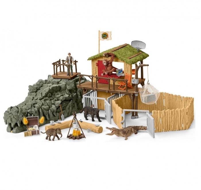 Schleich Игровой набор Исследовательская станция джунглей КрокодилИгровой набор Исследовательская станция джунглей КрокодилSchleich Игровой набор Исследовательская станция джунглей Крокодил способна порадовать как мальчиков, так и девочек. Он представлен игровой базой Croco, которая предназначена для ухода за животными джунглей и наблюдения за крокодилами.  Особенности: Ребенку предлагается заняться исследованием игрушечной пещеры, которая выполнена в виде головы аллигатора и хранит множество тайн Игрушечная постройка представляет собой здание исследовательского центра, в ней располагаются вольеры для животных Фигурки животных легко помещаются в игрушечные клетки. Они отличаются тщательной проработкой деталей и выглядят весьма реалистично В комплект также входят аксессуары, которые выполнены в виде посуды, они помогут маленьким ученым устроить перерыв между поисками Благодаря набору дети смогут воплотить самые разнообразные игровые сюжеты Игра с набором поможет детям развить воображение, внимательность, усидчивость, заботливость, а также расширить свои познания в зоологии. В комплекте: пещера в форме головы крокодила с тайником для сокровища здание исследовательской станции с вольерами для животных смотровая площадка с люком фигурка исследователя крокодил черная пантера орангутан слоненок сундук с золотыми монетами хрустальный череп ящик с инструментами ученых ноутбук бинокль костер посуда (котелок для костра, кружка, тарелка) складной стул бревно гамак.<br>