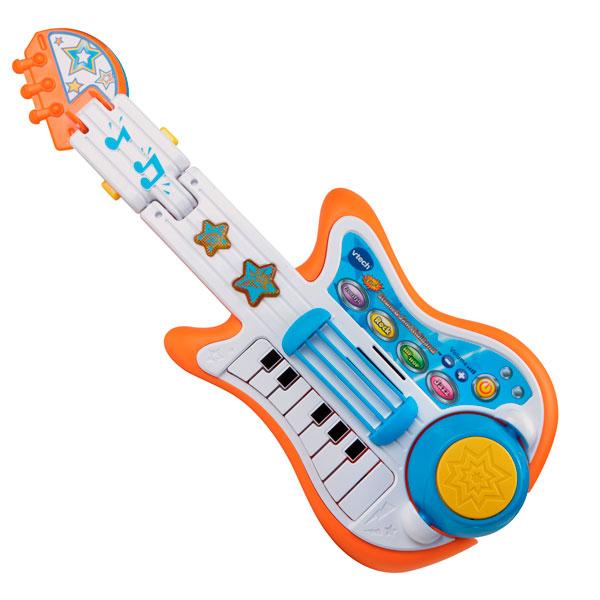 Музыкальная игрушка Vtech Моя гитараМоя гитараМузыкальная игрушка Vtech Моя гитара со светом и звуком может стать целым оркестром с барабанами и пианино — в руках юного виртуоза это вполне возможно! Играя свои собственные мелодии маленький музыкант может переключиться с гитары на барабан, клавиши или тарелку.  Особенности: В арсенале гитары есть 13 известные мелодий из мультфильмов, которые можно играть, вновь и вновь срывая аплодисменты восхищенных слушателей. Удобный ремень поможет удержать инструмент даже во время самой активной игры, а оригинальные световые и звуковые эффекты создадут впечатление целой шоу-программы Есть возможность включить одну из четырех ритмических кнопок - фристайл, рок, хип-хоп или джаз Есть регулятор громкости<br>