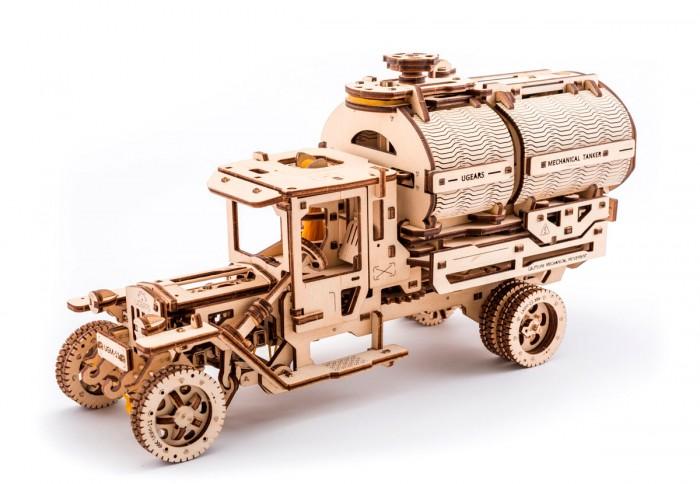 Конструктор Ugears 3D-Пазл Автоцистерна3D-Пазл АвтоцистернаКонструктор Ugears 3D-Пазл Автоцистерна – новая механическая модель с коллекции грузовиков.  Особенности: Имеет уникальный механизм открывания и позволяет поместить стандартную банку объемом 0,33 л Модель приводится в движение резиномотором, все работает на механике, все части механизма работают на тягах и силе гравитации Покрутив ручку на крыше цистерны, части конструкции открываются в стороны, и банка подается немного вперед.<br>