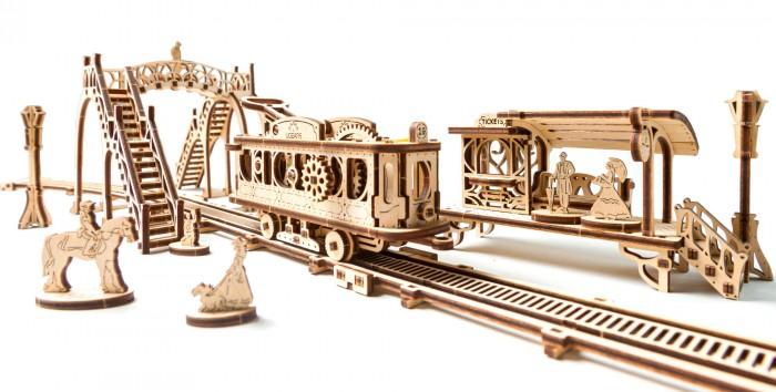 Конструктор Ugears 3D-Пазл Трамвайная линия3D-Пазл Трамвайная линияКонструктор Ugears 3D-Пазл Трамвайная линия - это первая модель из новой серии Механический город.  Особенности: Модель Трамвайная линия состоит из 14 элементов, созданных в удобном масштабе С одной стороны, все части модели интересно собирать, с другой — после сборки они превращаются в механические игрушки с уникальным дизайном, в которые вы погружаетесь так, что не можете оторваться  Модель Трамвайная линия имеет яркие заметные подвижные механические элементы и выполнена полностью из дерева. Это целый механический мир, который можно расширять следующими моделями серии Механический город  Собирается на столе без клея, специальных инструментов и даже… без зубочисток.<br>