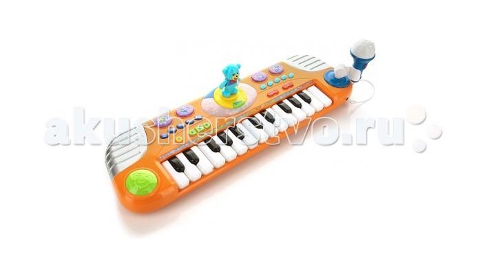 Музыкальная игрушка Играем вместе Пианино Маша и медведь с танцующим медведемПианино Маша и медведь с танцующим медведемПианино Играем Вместе Маша и медведь с танцующим медведем и со световыми эффектами для творческого малыша.    Особенности:    Мишка на пианино танцует под музыку и машет лапками.   У пианино 25 светящихся клавиш, оно воспроизводит звуки 5 музыкальных инструментов, 4 звуковых эффекта, имеет 15 демонстрационных мелодий.   У пианино регулирующиеся громкость и темп воспроизведения.  Также имеется функция записи.   В комплект входит настоящий микрофон.<br>