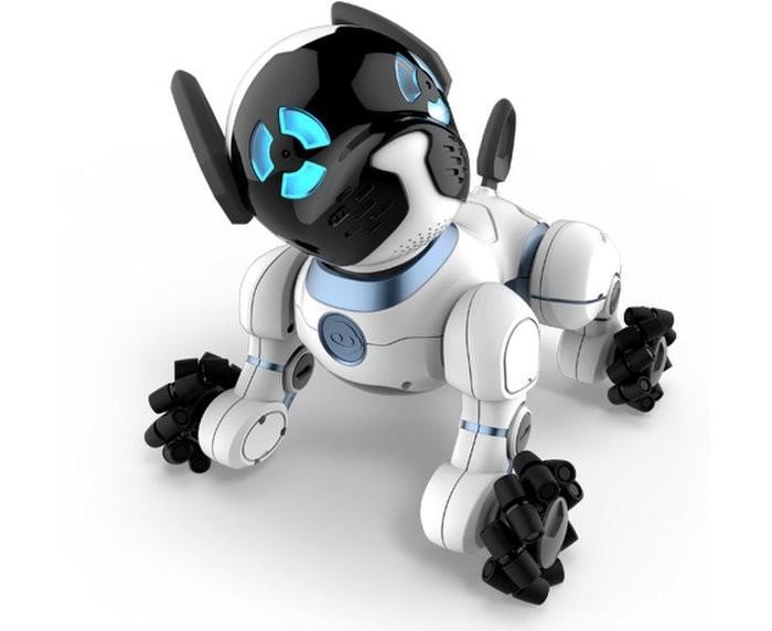 Интерактивная игрушка Wowwee Робот Собачка ChipРобот Собачка ChipИнтерактивная игрушка Wowwee Робот Собачка Chip 0805 - это активная собачка с искусственным интеллектом. Чтобы управлять собачкой CHiP, нужно загрузить на смартфон специальное приложение. Кроме того, можно давать команды с помощью браслета и шара, которые идут в комплекте. Чип прекрасно ориентируется в пространстве с помощью датчиков. Собачка очень подвижная и активно передвигается.  Компания WowWee, специализирующаяся на создании высокотехнологичных игрушек, представила нового робота – собаку по кличке CHiP. Игрушка представляет собой роботического черно-белого щенка с синими светодиодами и значительным количеством различных датчиков.   Голова собаки-робота CHiP представляет из себя массив из тщательно скрытых инфракрасных сенсоров, которые дают ему 360-градусный обзор, который он использует, чтобы найти мячик и кровать для зарядки. Чип также оснащен Bluetooth, чтобы он мог подключаться к специальному браслету. Владельцам придется носить браслет, чтобы хвалить собаку-робота — и чтобы ЧИП мог следить за вашими перемещениями и находить вас, если вы позовете.   ЧИП выглядит как милый маленький щенок. Его лапы - настоящее инженерное чудо. Небольшие колесики вращаются с высокой скоростью на основных механических колесах. В пользу этого необычного решения говорит тот факт, что CHiP  может мгновенно поворачивать в практически любом направлении. Что, в сочетании с поражающей скоростью интерактивного щенка, позволяет ему делать вещи свойственные настоящим собакам.   Собака-робот CHiP умеет видеть, догонять и ловить мяч, даже когда он не катится прямо на него. Мяч оснащен ИК датчиками (он переходит в спящий режим, когда не используется, для сохранения заряда аккумулятора) и он общается с ЧИПом, так что робот может видеть его во время игры.   В демонстрациях щенок CHiP невероятно ловок и быстр — но, подобно тому, как малыш учится ходить, с трудом сохраняя равновесие, CHiP также иногда терял скорость или ускорялс