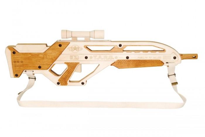 Конструктор Targ Сборная деревянная модель InvaderКонструкторы<br>Targ Сборная деревянная модель Invader — детализированная копия концептуального карабина Сарыч со множеством конструктивных подробностей, повторяющих прототип модели. Оригинальный дизайн корпуса и штатный прицел придают винтовке космический вид. Вам понадобится совсем немного времени и усилий, чтобы готовая деревянная модель оказалась у вас в руках и стала частью вашей собственной коллекции конструкторов T.A.R.G.! Внутренний механизм модели издает звук. К готовой винтовке крепится наплечный ремень. Набор полностью укомплектован. Для сборки вам потребуется только крестовая отвертка. Лак и клей, входящие в набор, не токсичны и безопасны для детей.    Характеристики карабина  Калибр.220 5,56 мм или 308 Win 7,85 мм Емкость магазина — 10 патронов  Начальная скорость полета пули до 900 м/с  Дальность эффективной стрельбы — 600 м с оптическим прицелом Компоновка bullpup. Прототипом полуавтомата Invader служит концептуальный карабин Сарыч, разработанный в России в 2009 году.  Пластиковый корпус космического дизайна типа буллпап, в котором спусковой крючок расположен перед съемным магазином и ударным механизмом, позволяет расположить длинный ствол над коротким прикладом. Благодаря этому компактное оружие обладает характеристиками полноразмерных винтовок, идеально для использования в стесненных городских условиях и помещениях. Используется с оптическими прицелами кратности 4-8х. Это интересно Винтовка полуавтомат — самозарядное оружие, в котором выброс стрелянной гильзы и заряжание нового патрона происходит после выстрела автоматически благодаря энергии пороховых газов. Винтовку, в которой необходимо вручную передергивать затвор скользящего типа после каждого выстрела, называется болтовка.  Размер модели: 64 #215; 19 #215; 3 см  Вес модели: 1300 г  Время сборки: 1–2 часа