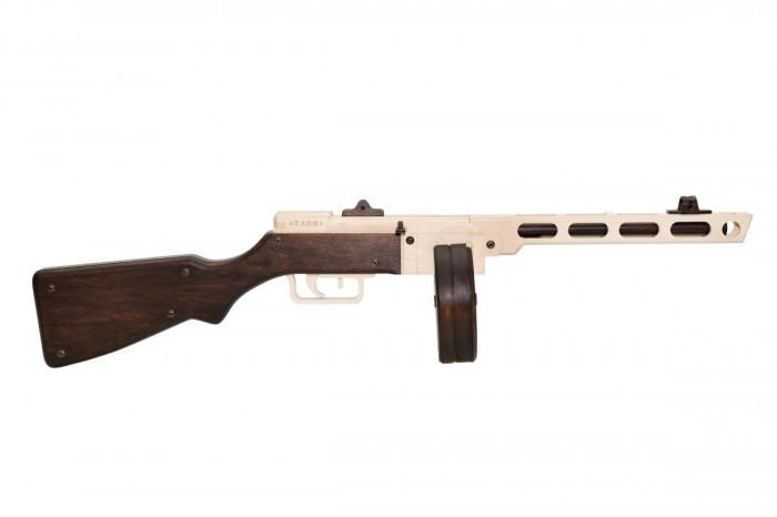 Конструктор Targ Сборная деревянная модель ППШ-41Сборная деревянная модель ППШ-41Targ Сборная деревянная модель ППШ-41 — модель-макет самого известного пистолета-пулемета советских вооруженных сил времени Великой Отечественной войны. Необычный ствол и мощный корпус делают этот пулемет наиболее заметным среди всех моделей T.A.R.G. Автомат игрушка ППШ из дерева непростой в сборке, но результат несомненно порадует даже самого взыскательного моделиста. Внутренний механизм модели издает звук. Набор полностью укомплектован. Для сборки вам потребуется крестовая отвертка. Из-за характерных особенностей конструкции ствола модели рекомендуем при склейке использовать струбцины, которые входят в комплект. Лак и клей из набора не токсичны и безопасны для детей.   Характеристики ППШ  Калибр — 7,62 мм, пистолетный патрон длиной — 25 мм  Скорострельность — 900 выстрелов в минуту  Начальная скорость полета пули — 500 м/с  Дальность эффективной прицельной стрельбы — 300 м  Стрельба очередями или одиночными выстрелами.  Пистолет-пулемет советского конструктора — оружейника Георгия Семеновича Шпагина поступил на вооружение Советской Армии в 1941 году. Выпущенный в количестве 6 миллионов штук, ППШ автомат до сих пор используется в армиях государств по всему миру. Простота и надежность гарантирует 5000 выстрелов без чистки и разборки оружия. Используется с магазинами двух типов — секторным на 35 и барабанным на 71 патрон. Скорость выстрела и прицельная дальность в два раза превосходят немецкий MP-40 и английский Томпсон. В наше время продаётся модификация ППШ-41 — охотничий карабин для одиночной стрельбы.   Это интересно  Пистолет-пулемет Шпагина стал символом советского солдата времен Великой Отечественной войны, героем множества кинофильмов и компьютерных игр. Одиночный выстрел поражал цель на расстоянии 350 метров, что являлось недостижимым показателем для зарубежных аналогов того времени.  Масштаб 1:1  Размер модели: 84 &#215; 18 &#215; 15 см Вес модели: 2500 г  Время сборки: 3–4 час