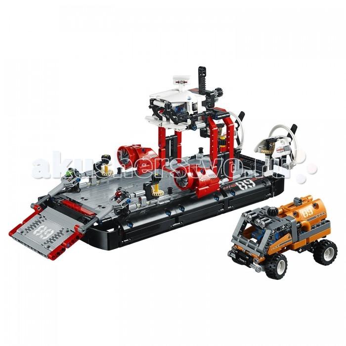 Конструктор Lego Technic Корабль на воздушной подушкеTechnic Корабль на воздушной подушкеLego Technic Корабль на воздушной подушке состоящий из 1020 деталей. Из деталей конструктора вы можете собрать Корабль на воздушной подушке или Реактивный катер. Корабль на воздушной подушке выполнен в черно-серой цветовой гамме с присутствием красных и белых деталей. При сборке корабля вы заметите, что у вас остаются детали и на маленький оранжевый экспедиционный грузовик со съёмным контейнером для груза. Сверху у него есть черненькая шестеренка, которая позволит управлять вам передними колесами. Например, поверните ее вправо, и они повернутся направо. Сзади у него находится съемный контейнер для груза. Если его отсоединить, то у машинки покажется большой вместительный багажник. На крыше кабины водителя установлены 4 прожектора. Также у грузовичка четыре прорезиненных колеса, задние - с амортизаторами.  Корабль очень длинный, на его черных бортах красуется цифра 89, спереди находится рампа, по которой грузовичок заезжает на борт. Она поднимется и опускается с помощью двух шестеренок, расположенных рядом с ней. Далее мы видим два больших красных двигателя, у которых вращается пропеллеры. В задней части корабля расположен огромный грузовой кран с белой кабиной оператора, а снизу находится погрузочная платформа. Выгружайте контейнеры с помощью черной шестеренки сверху. Двойные задние вентиляторы вращаются по часовой стрелке, а еще их можно крутить влево и вправо с помощью огромной шестеренки.<br>