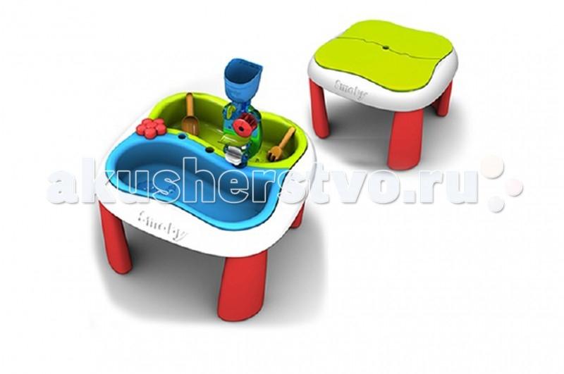 Smoby Столик-песочница для песка и водыСтолик-песочница для песка и водыSmoby Стол-песочница для песка и воды, который способен решать большие задачи в развитии детей. Стол-трансформер -идеальное место для разнообразных игр. Вместе с друзьями Ваши дети могут лепить из песка, ставить опыты на воде и наблюдать за результатами, рисовать, играть в настольные игры.  Малыши будут учиться взаимодействовать друг с другом и приобретут навыки игры в коллективе. Украсит любую дачу и станет любимым местом для игр Вашего ребенка и его друзей. Оцените это сами!   Особенности: Столик имеет 2 отсека, расположенных рядом друг с другом: один -для песка, второй- для воды.  На столе есть игровая мельница для воды, через которую вода переливается без перерыва.  В центре стола находится отверстие для пляжного зонта (Зонт в комплект не входит).  После игры стол можно накрыть крышкой. Стол легко собрать и также легко разобрать.  Удобная высота стола- 46 см.  Для игры в песочнице в комплекте можно найти лопатку, грабельки и две формочки, чтобы лепить из песка фигурки.  Если же дети заходят порисовать за столом или поиграть в настольную игру, отсеки для песка и воды можно накрыть специальной крышкой и превратить игровой центр в обычный широкий и удобный стол.  Стол-песочницу можно установить как на улице, так и в любой комнате. Простой монтаж. Все детали выполнены из качественной пластмассы. Идеальный европейский пластик, не подверженный выгоранию на солнце и деформации от перепада температур.  Кроме пользы от развлечений и игры, этот необычный стол способен решать серьезные воспитательные задачи, развивает много хороших качеств: дружелюбие, заботу, внимательность, ответственность, смелость, терпение и увлеченность. Рекомендуется для детей от 1-2 лет.  Рекомендуем устанавливать на ровной устойчивой поверхности.<br>