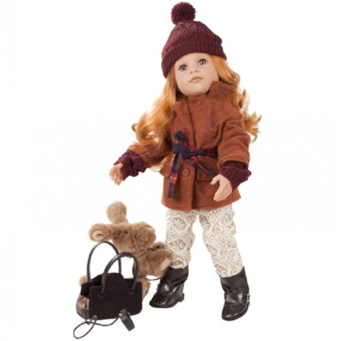 Gotz Кукла Ханна с собачкой и аксессуарами 50 смКуклы и одежда для кукол<br>Gotz Кукла Ханна с собачкой и аксессуарами 50 см - эта прелестная кукла  станет замечательным подарком для каждой девочки. С красивой куклой, которая так похожа на настоящую девочку, можно проводить много времени вместе, придумывая увлекательные сюжеты для игр.   Кукла Ханна с твердым виниловым телом подходит для активных игр дома и на улице. Куклу можно переодевать и делать различные прически. Ручки и ножки у куклы не сгибаются. Голова поворачивается. Глазки не закрываются.   Кукла, одежда и аксессуары выполнены из качественных материалов с учетом необходимых стандартов, соответствующих европейским нормативам. Куклу можно мыть, для поддержания одежды в опрятном виде рекомендуется щадящая машинная стирка при температуре 30 градусов.   В наборе:  Ханна Куртка с ремнём Пуловер Штаны Сапоги Шапка Собачка с плащиком и поводком Сумочка для собак