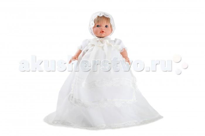 Dnenes/Carmen Gonzalez Пупс Мончи 34 см 52003Пупс Мончи 34 см 52003Dnenes/Carmen Gonzalez Кукла Мончи, 34 см.  Очень красивая кукла-пупс испанского производителя традиционных кукол для детей Dnenes.Высота куклы - 34 см.Кукла одета в нарядное и праздничное белоснежное платье. Платье имеет короткие рукава фонарики на резинке, отделанные тонким кружевом, завышенную талию, очень длинную и пышную многослойную юбку и застежку - липучку на спине. Помимо основы из белоснежного капрона, юбка имеет импровизированный передник, богато украшенный кружевом и бантиками из белых атласных лент. Низ юбки тоже декорирован кружевом. Подкладка выполнена из белоснежной хлопчатобумажной ткани.  На голове у куклы одет чепчик из той же ткани, что и платье, украшенный кружевом и с завязочками из атласных лент.В комплект входят белые панталончики. Ножки имеют форму близкую к анатомической.Кукла не имеет запаха и обладает приятным тактильным эффектом. Кукла Carmen Gonzalez продается в красивой подарочной коробке с прозрачным окошком.  Кукла-пупс Мончи  Тело  Комбинированное: твердый винил, мягко набивные вставки Волосы  Светлые, хорошо прошитые Глаза  Голубые, стеклянные, без ресничек, не закрываются Одежда  Высококачественный текстиль. Праздничное белоснежное платье  Головной убор  Белый чепчик Детали  Белые панталончики Обувь  Нет Дизайн  Изысканный. Детали лица, рук и ножек великолепно проработаны  Упаковка  Красивая подарочная коробка с прозрачным окошком.<br>