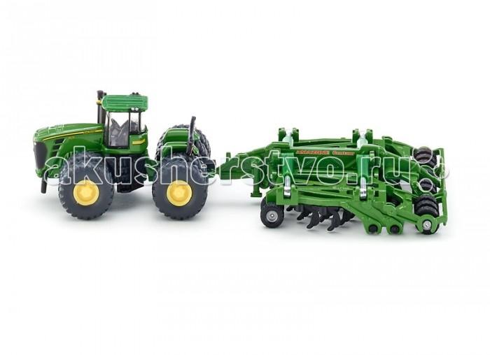 Siku Трактор c прицепом-плугом 1856Машины<br>Siku Трактор c прицепом-плугом 1856 обязательно понравится всем коллекционерам игровых моделей машинок и сельскохозяйственной техники.   Игрушечная модель трактор John Deere 9630 с культиватором, корпус трактора и прицепа выполнены из металла, кабина трактора из пластмассы, колёса выполнены из резины и вращаются, можно катать.  Культиватор отцепляется от трактора.