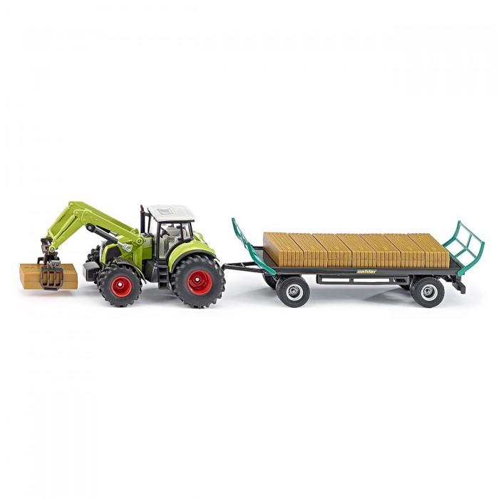 Siku Трактор с захватом и прицепом Claas 1946Машины<br>Siku Трактор с захватом и прицепом Claas 1946 сможет познакомить ребенка со сложной сельскохозяйственной техникой, а также станет достойным пополнением для коллекционеров.  Трактор с прицепом выполнен в серо-зеленом цвете и выглядит очень реалистично. К кабине трактора прикреплен прицеп с грузом. С помощью фронтального погрузчика можно захватить груз и погрузить его на платформу прицепа. Мощные колеса трактора позволяют катать игрушку практически по любым поверхностям. С трактором можно играть отдельно.  Детально проработанные детали набора делают его максимально реалистичным и интересным для игры. Набор достойно украсит коллекцию каждого любителя моделей автомобилей и сельскохозяйственной техники.  Масштаб: 1:50.