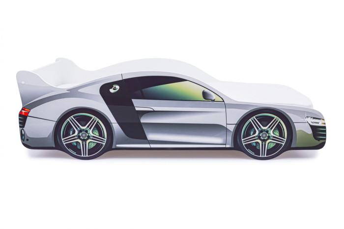 Подростковая кровать Бельмарко машина АудиКровати для подростков<br>Бельмарко Подростковая кровать-машина Ауди – это оригинальная и качественная продукция в мире детской мебели. Кроватка придется по душе любому мальчишке, мечтающему иметь свой автомобиль. Это игровая зона днем и в то же время, комфортное спальное место ночью, где обязательно приснятся захватывающие приключения. Теперь вам не придется уговаривать малыша лечь спать.  Для безопасности ребенка в дизайн модели защитные бортики, все линии конструкции сделали плавными, а торцы оклеили кромкой. Кроме того, кровать может выдержать большую нагрузку (не менее 200 кг), поэтому можно не опасаться, что она сломается во время активных игр.  Изделие представляет собой крепкое устойчивое основание из деревянных лат и ламинированный корпус из ЛДСП кл. Е1, которые легко монтируются между собой при помощи фурнитуры, входящей в комплект. Также прилагается инструкция по сборке и необходимый инструмент.   Преимущества кроватей: При производстве мы используем ЛДСП максимально высокого качества (гладкая и приятная на ощупь поверхность, высокая плотность материала, отсутствие специфического запаха), высший класс Е-1 (для детских изделий) Отсутствие открытых участков ЛДСП (ГОСТ) Все торцы заклеены кромкой ПВХ с помощью специализированных станков, что улучшает эстетический вид кровати Только у нас используется прямая фотопечать на ЛДСП безопасными ультрафиолетовыми чернилами Все габаритные размеры кровати соблюдены в строгом соответствии с ГОСТом Боковые линии кровати позволяют взрослому удобно сидеть пока ребенок засыпает, при этом ребенок никогда не упадет во сне Легкая сборка в течении 10 минут, все что нужно для этого уже внутри, дополнительные инструменты не требуются. Подробная инструкция по сборке Деревяные прочные латы, выдерживающие самую высокую нагрузку. 200 кг Латы позволяют матрасу дышать, если он намокнет, достаточно его перевернуть и он высохнет Особенности: Размер кровати(см): 170х75х50 (ДхШхВ) Размер спального