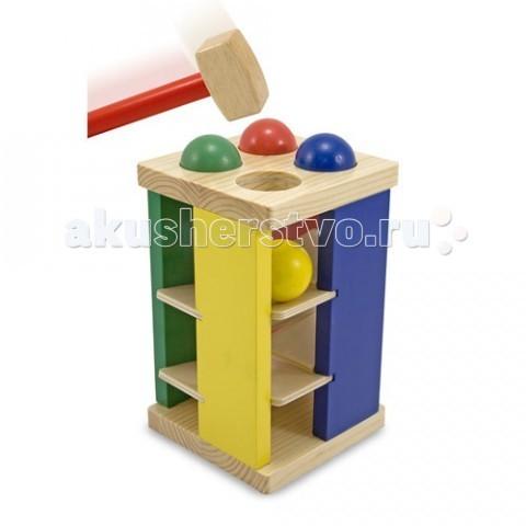 Деревянная игрушка Melissa &amp; Doug Классическая Игра с молоткомКлассическая Игра с молоткомДеревянная игрушка Melissa & Doug Классическая Игра с молотком - выполнена в форме платформы с шариками, которая доставит несказанное удовольствие Вашему ребенку.  Цель игры: ударяя молотком по ярким шарам, протолкнуть их сквозь отверстия и затем наблюдать, как они перемещаются по наклонным поверхностям на нижний уровень игрушки.   Такой способ развлечения развивает детское внимание, координацию движения, моторику пальчиков и рук, точность.  Компания Melissa&Doug придерживается самых высоких стандартов качества и безопасности детских образовательных продуктов для детей. Melissa & Doug - это один из ведущих брендов деревянных игрушек, используемые компанией покрытия и красители нетоксичны.<br>