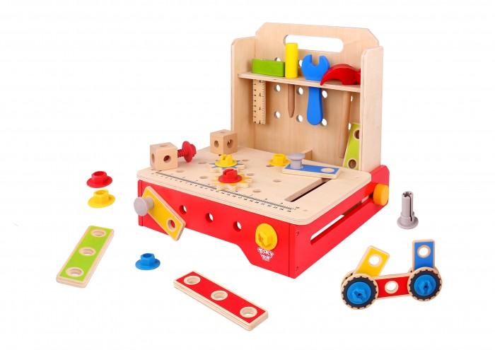 Деревянная игрушка Tooky Toy Набор Мастерская TKC 465Деревянные игрушки<br>Tooky Toy Набор Мастерская TKC 465  Игрушка деревянная Мастерская с инструментами. Раскладной, верстак для соединения столешницы с линейкой и отверстиями для винтов, и полки для инструментов. Все это стоит на красной рамке, которая также функциональна.   Простые, основные инструменты – молоток, валик, ключ и кронштейн являются деревянные и разработан таким образом, чтобы они были полностью безопасны для маленького мастера.  Комплект также включает в себя доски с отверстиями и винтами. С помощью специальных деталей малыш свяжет различные элементы.