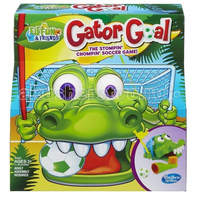 Hasbro Настольная игра Гол КрокодильчикаНастольная игра Гол КрокодильчикаHasbro Настольная игра Гол Крокодильчика.  Стань настоящим футболистом с Крокогол! Игра Гол Крокодильчика не оставит равнодушным ни одного ребенка. В нее можно играть одному или компанией друзей.  Цель игры - забить в рот гаторифика мячик раньше своих соперников. Для этого необходимо положить гаторифика на землю, затем потянуть назад флажок, тем самым открыв рот игрушки и обнажив четыре зуба. Далее следует вставить мяч в пусковой механизм, прицелиться в зубы гаторифика и наступить ногой на спуск. Выигрывает игрок, после броска которого гаторифик начинает вращать глазами.  В комплект игры входят:  игрушка в виде гаторифика крокодила  пусковой механизм  флажок  мяч стилизованный под футбольный правила игры на русском языке.<br>