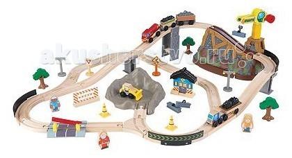 KidKraft Железная дорога-деревянный игровой набор Горная стройка в  контейнереЖелезная дорога-деревянный игровой набор Горная стройка в  контейнереKidKraft Железная дорога-деревянный игровой набор Горная стройка в контейнере включает в себя 61 деталь из качественной древесины в виде деревьев, дорожных значков, весёлых человечков и других элементов. Они легко помещаются в специальное ведро, в котором можно хранить конструктор.   Малыш не будет разбрасывать детали, соблюдая порядок в комнате. Прочные элементы делают игру безопасной, а подробная инструкция поможет при сборке.<br>