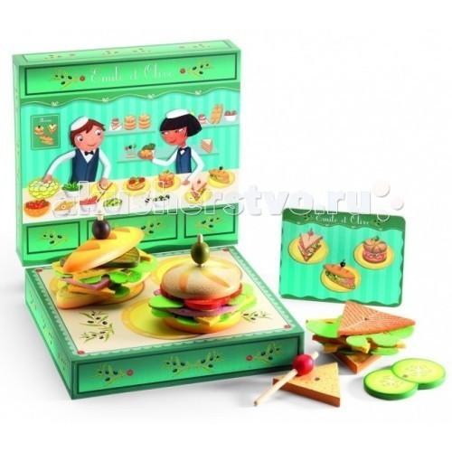 Деревянная игрушка Djeco Сэндвичи от Эмиля и ОливДеревянные игрушки<br>Деревянная игрушка Djeco Сэндвичи от Эмиля и Олив. Вашему малышу понравится готовить интересные сэндвичи из разнообразных начинок. Рецепт прост – два кусочка булки, сыр, ветчина, огурцы, помидоры, салатный лист, а сверху можно украсить бутерброд оливкой.  В набор входят: два кусочка булки сыр ветчина огурцы помидоры салатный лист оливка.  Готовить можно по рецепту (доска с изображениями бутербродов в комплекте) или придумать свой фирменный сэндвич, и угостить родителей.