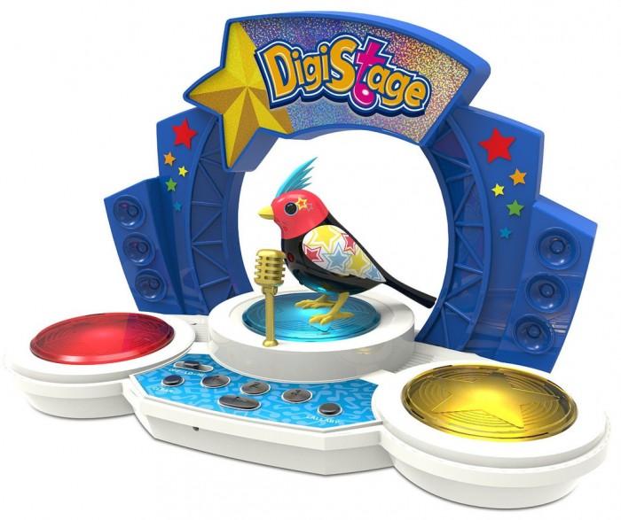 Интерактивная игрушка Digibirds Птичка со сценойПтичка со сценойПтичка Digibirds со сценойт- это уникальная интерактивная игрушка, которая непременно порадует вашего ребенка.  DigiBirds - интерактивные птички, которые ведут себя как настоящие! Они двигаются, воспроизводя узнаваемые повадки птиц, и даже могут петь. Чтобы активировать птичку, просто подуйте на нее, выбрав одиночный режим, а чтобы она начала петь, свистните в свисток, встроенный в кольцо - вы услышите одну из 55 записанных мелодий.  Птиц можно синхронизировать! Выберите режим хора и разместите нескольких птичек на расстоянии не более 15 см друг от друга - они будут петь все вместе, а корифеем хора станет та птица, которую включили первой. Таким образом можно синхронизировать неограниченное количество птиц.   На игрушечной сцене расположены кнопки проигрывания мелодий. Птичка может петь соло или в такт играющей мелодии в режиме хор. Вы можете слушать мелодии в произвольном порядке (кнопка SHUFFLE) или составить собственный плейлисте (к игрушке прилагается карточка с 4-х значными кодами популярных песен).   На игрушечной сцене помещается до трех птичек Digibirds, вы можете устроить настоящее представление, синхронизировав сразу несколько птичек. Главным в хоре становится персонаж, которого включили первым.   В наборе:    птичка  сцена с кнопками управления игрушкой  микрофон  свисток для активизации птички  наклейки   Требуются батарейки: 3 х LR44 (не входят в комплект)  Размер птички: 9х7,5 см<br>