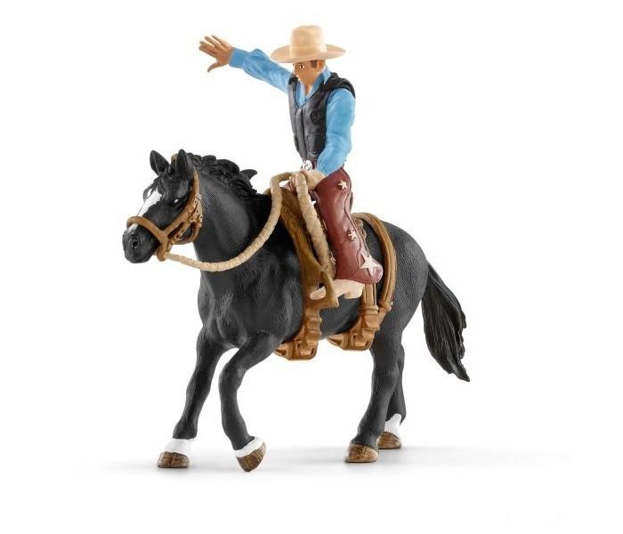 Картинка для Schleich Фигурка Ковбой в седле на необъезженной лошади