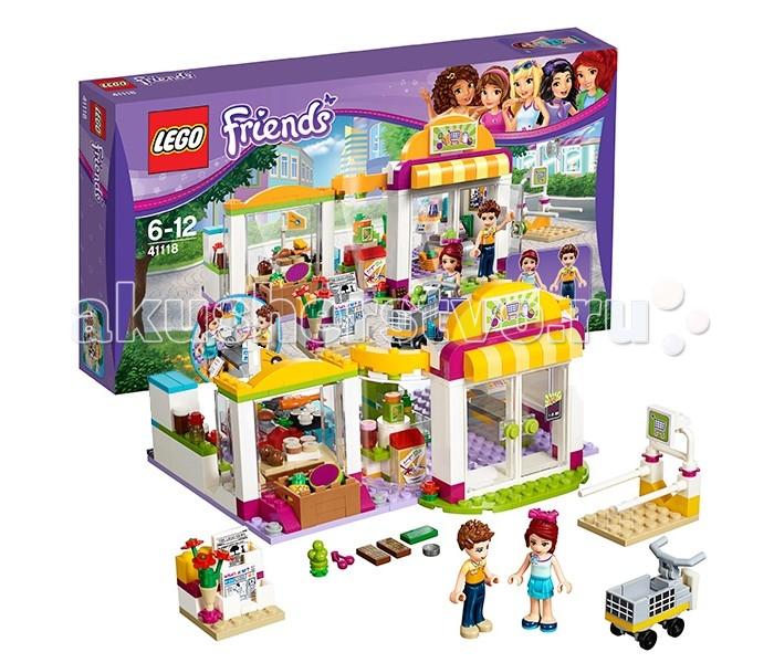 Конструктор Lego Friends 41118 Лего Подружки СупермаркетFriends 41118 Лего Подружки СупермаркетКонструктор Lego Friends 41118 Лего Подружки Супермаркет   Городской супермаркет представляет собой большое одноэтажное здание, построенное в самом центре Хартлейк-сити. Его яркая вывеска и полосатый козырёк заметны издалека. На площадке перед входом всегда много покупателей. Кто-то идёт за тележкой, припаркованной на специальной стойке с перилами, кто-то рассматривает выставленные на улицу журналы и газеты, а кто-то заглядывает в большие прозрачные окна, чтобы узнать, какие новинки их ждут внутри магазина. А посмотреть здесь действительно есть на что!   За высокими распашными дверями располагаются многочисленные ряды с продуктами. Сначала идут овощи и фрукты, которые перед покупкой необходимо взвешивать на электронных весах. Рядом с ними виден бакалейный отдел, в котором выставлены соки, варенье и хлопья для завтрака. Напротив – вращающийся стенд с косметическими средствами. Основные продукты можно найти в самом центре супермаркета. Мясомолочный прилавок предлагает покупателям куриные окорочка и сыры, а рыбный прилавок – суши, замороженную или живую рыбу из аквариума.   Тем, кто любит выпечку и сладости, обязательно понравится ассортимент кондитерской-пекарни. Печенье, шоколад, пирожные и яблочные пироги не оставят равнодушными даже тех, кто следит за фигурой. Завершив покупки и наполнив доверху тележку, следует пройти на кассу. Здесь приветливый сотрудник магазина поможет выложить все продукты на кассовую ленту, а затем выдаст чек и поблагодарит за покупку.  В наборе Лего 41118 присутствуют 2 куколки, а также множество аксессуаров: тележка для продуктов, газеты, цветы, арбуз, ананас, вишня, виноград, лимон, апельсин, морковь, хлопья для завтрака, сок, варенье, шоколад, куриный окорочок, сыр, рыба, суши, яблочные пироги, печенье, пирожные, молоко, бутылки, банки, расчёска, помада, 2 флакона духов, монета, денежная банкнота, список покупок, весы, щипцы, сумка и кассовый ап