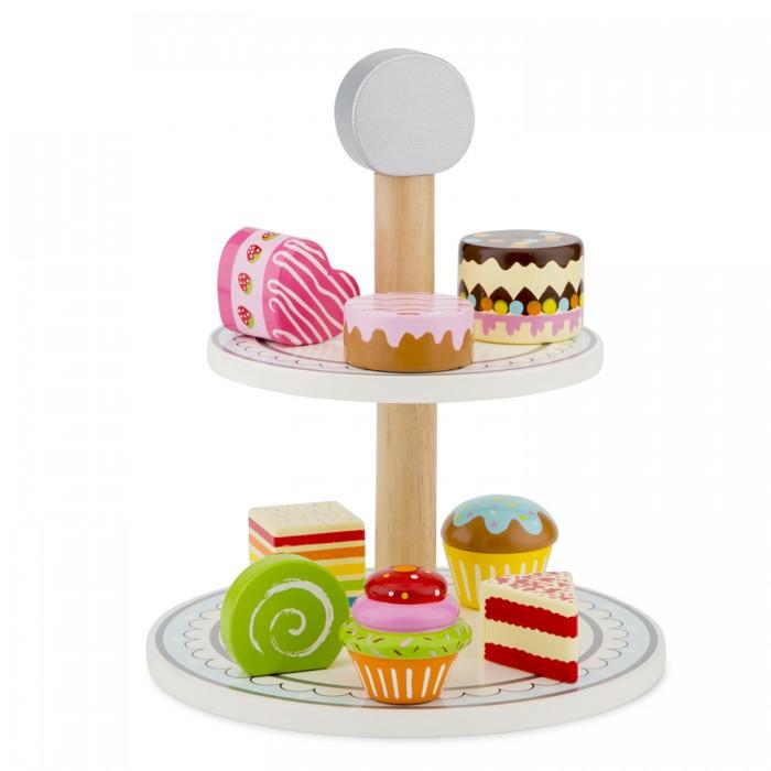 Фото - Деревянные игрушки New Cassic Toys Игровой набор Пирожные с подставкой деревянные игрушки new cassic toys игровой набор инструментов 12 предметов