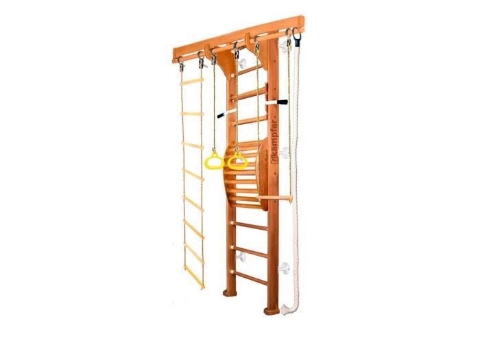 Kampfer Домашний спортивный комплекс Wooden ladder Maxi Wall 2.42 мШведские стенки<br>Kampfer Домашний спортивный комплекс Wooden ladder Maxi Wall 2.42 м включает в себя тренажер для спины.   Тренажерный комплекс предназначен для занятий физическими упражнениями, позволяющими расслаблять, разминать и массировать мышцы спины в домашних условиях.Предназначен для улучшения осанки, поэтому в первую очередь необходимо привлечь к занятиям подростков, и даже маленьких детей. Им неприменно понравиться занятия на тренажере под Вашим руководством и присмотром.При помощи различных упражнений на нем Вы сможете укрепить мышцы спины и многие другие группы мышц. Регулярные занятия очень полезны для Вашего здоровья. Уделяя им по 15-20 минут в день Вы сами почувствуете как в скором времени окрепнет Ваше тело и выпрямится осанка.  Подходит для детей в возрасте от 4 лет и рекомендован для установки в домашних условиях и в детских учреждениях. Конструкция была выполнена из натурального дерева, все края деталей немного скруглены, места креплений болтов закрыты декоративными пластиковыми заглушками обеспечивая большую безопасность для ребенка.  Особенности:  Высота: 2,42 м  Ширина шведской стенки: 65 см Ширина стойки лестницы : 10 см Длина перекладины для навесного оборудования: 1,60 м Размер выступа от стены: 45 см Размер крепления к стене: 10 см Высота деревянной стойки: 2.40 м Высота нижних кронштейнов-упоров: 2 см Допустимая нагрузка: 120 кг. Комплектация:  шведская стенка  канат  кольца  верёвочная лестница трапеция тренажер Kampfer Posture 2 с турником. Размеры упаковки:  1 место (шведская стенка): 242 х 26 х 12 см  2 место(Posture): 74 х 56 х 21 см.