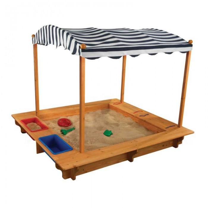 KidKraft Песочница с тентомПесочницы<br>Kidkraft Песочница с тентом - это неизменный атрибут лета.    Малыши обожают возиться в песке, играть в искателей, строить замки и города, лепить куличикии - это занимает их внимание на долгие часы.   Классическая форма, большой навес, прочная и безопасная деревянная конструкция. Удобрые ящики для хранения игрушек, савочков и лопаток.