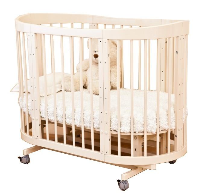 Кроватка-трансформер Можга (Красная Звезда) Паулина-2Паулина-2Можга (Красная Звезда) Кроватка-трансформер Паулина-2 - эта стильная и лаконичная кроватка легко впишется в любой современный интерьер детской комнаты и будет расти вместе с вашим малышом. Когда ребенок совсем маленький, до 6 месяцев, она послужит ему уютной колыбелькой с маятниковым механизмом продольного качания. Колесики обеспечивают мобильность колыбели, при необходимости их можно, также как и маятник, зафиксировать с помощью стопоров. Пеленальный столик поможет маме комфортно переодевать малыша.  Позднее колыбель трансформируется в кроватку с таким же качанием и тремя уровнями ложа. Благодаря перфорации дна обеспечивается оптимальная вентиляция. Круглые стойки позволяют малышу легко хвататься и удобнее вставать на ножки. Кроватка и колыбелька имеют дополнительную опцию – устройство автоматического качания кровати на пульте управления: приобретается отдельно за дополнительную плату.   Когда малыш научится самостоятельно забираться в кроватку, часть бокового ограждения можно снять и использовать Паулину-2 как диванчик. Установив дно кроватки в самое нижнее положение, можно сделать мобильный глубокий манеж. Кровать-трансформер растет вместе с ребенком, и когда он вырастет из своей кроватки, обеспечит ему комфортное место для игр и занятий, трансформируясь в столик и 2 кресла. Материал: массив березы.  Варианты трансформации:  Пеленальный столик и круглая колыбель  Овальная кроватка  Диванчик  Манеж  Столик и два кресла.<br>