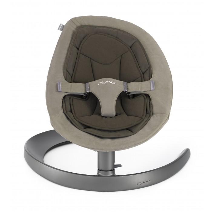 Nuna Шезлонг Leaf Curv RockerШезлонг Leaf Curv RockerNuna Шезлонг Leaf Curv Rocker  Появилась возможность устанавливать на шезлонг Wind-механизм качания (дополнительный аксессуар)  Особенности: модный актуальный дизайн для современной семьи очень плавное и тихое покачивание энергосберегающая технология, без использования батареек, мотора и электричества изготовлено с применением ткани Oeko-Tex®, безопасной для здоровья детей после лёгкого толчка движение продолжается в течение более двух минут съёмная подушка сиденья пригодна для машинной стирки съёмная вставка из натурального хлопка пригодна для машиннойстирки 3-точечный настраиваемый ремень на застёжке-липучке с мягкими вставками блокиратор движения устойчивое основание кресло легко снимается с основы для быстрой и лёгкой сборки  и разборки  Дополнительная информация: рекомендуется для детей с рождения, максимальная нагрузка 60 кг размеры изделия (ДхШхВ): 72.7х71х46 см вес изделия: 5.47 кг соответствует стандарту ASTM F2167 производство сертифицировано по стандарту ISO 14001<br>