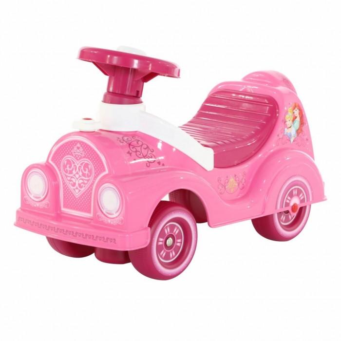 Каталка Полесье автомобиль Disney ПринцессыКаталки<br>Полесье Автомобиль-каталка Disney Принцессы для девочек розовогоо цвета с блестящими наклейками как у звезды.   Игрушка станет любимой детской машинкой на долгое время, в первую очередь потому, что она имеет неординарный дизайн.  На руле гудок с 2-мя мелодиями. Рулем можно управлять поворотом передней оси, что дает ребенку возможность самому выбирать направление движения. Ребенок, держась за спинку сидения, может толкать каталку перед собой.   Так же за спинку  каталку можно переносить. Колеса каталки без протектора, поэтому ее можно использовать и дома и на площадках со специальным покрытием.