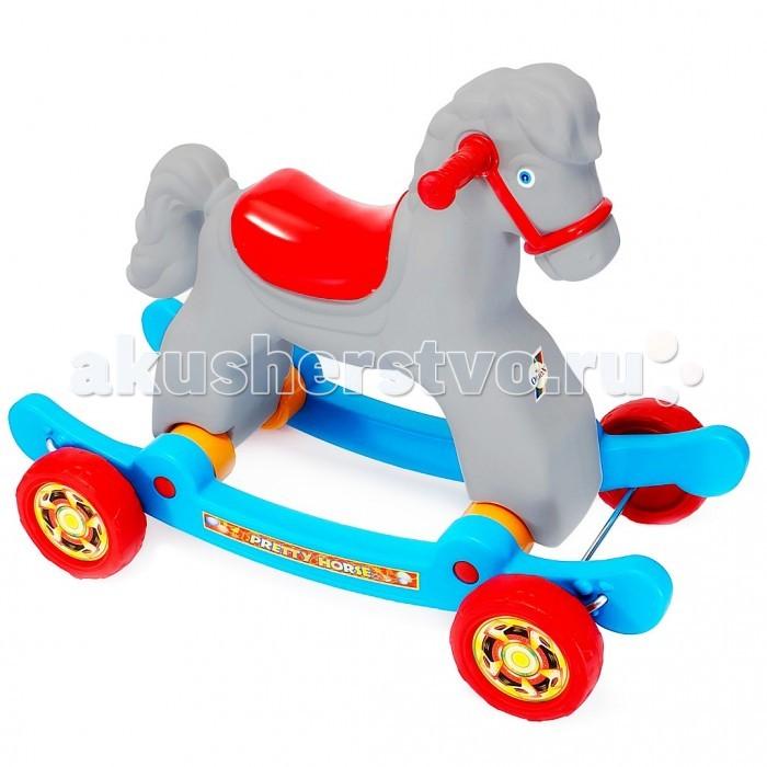 Качалка R-Toys Лошадка на колесахЛошадка на колесахКачалка R-Toys Лошадка на колесах  Трансформер 2 в 1 - качалка и каталка на колесах. Лошадка предназначена для детей от 9 месяцев.   Качалка - это незаменимая вещь в доме, когда Вы хотите занять и развлечь своего малыша. Всем детям нравится качаться, особенно если качалка - в виде любимого всеми детьми животного Лошадки. Но когда качалка на глазах превращается в каталку на колесах - это вдвойне приятно.  Эти 2 транспортных средства помогают в развитии малышей. Любой малыш с раннего возраста учится держать равновесие и балансировать телом. Но это получается не у всех детей и не сразу. Поэтому знатоки особенностей детского организма создают такие качалки-каталки, с помощью которых легче учиться удерживать равновесие и сохранять баланс.  На этой каталке ребенок быстрее и легче сможет понять как балансировать и сохранять равновесие. Он увидит, что ноги могут качаться свободно, но они готовы помешать падению. Ребенок быстро поймет, как управлять своим телом, а это позволит ему мыслить, самостоятельно принимать решения и развиваться.  Такая каталка - незаменимый помощник в развитии малыша. Ребенок развивается физически и укрепляет здоровье, он может ехать в дальние поездки и не уставать, преодолевать препятствия и не бояться упасть. Малыши быстрее начинают ходить, уверенно держать спину, пытаться  держать равновесие и балансировать всем телом.  А как радостно чувствовать себя маленьким наездником или наездницей на такой красивой белоснежной лошадке! У любого малыша это вызовет массу положительных эмоций. Теперь ребенок будет с интересом познавать окружающий мир и исследовать все больше пространства вокруг себя.  Это очень занимательно и полезно. Очень удобные рефленые ручки на руле с уплотненными и расширенными окончаниями рукояток. Если малыш упадет на бок, то рука будет в безопасности - удар придется на окончание рукоятки руля. Качалка- каталка - надежная и прочная.  Выполнена по самым современным технологиям и соответс