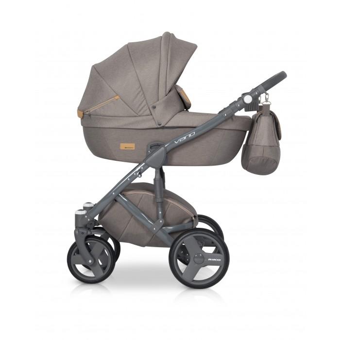 Коляска Riko Vario 2 в 1Vario 2 в 1Коляска Riko Vario 2 в 1 модель в современном, стильном дизайне.   Коляска Riko Vario обеспечит вашему малышу самые лучшие условия для увлекательных прогулок и комфортного полноценного сна во время прогулок на свежем воздухе. Ребенок будет прекрасно себя чувствовать в просторной люльке, а комфортное прогулочное сиденье для подросшего ребенка предоставит наилучшие условия для изучения окружающего мира. Эта модель коляски на алюминиевой раме обладает отличной проходимостью за счет легкого хода и надувных колес. Современная система амортизации колес позволяет легко преодолевать любые препятствия на прогулке, и при этом сохраняется мягкость хода, обеспечивая спокойный сон вашего малыша.   Особенности: Просторная пластиковая люлька Прогулочное сидение со всеми возможными регулировками Закрытая корзина Родительская сумка Вставки из премиальной кожи и улучшенное качество ткани с оригинальными расцветками Надувные колеса Алюминиевая конструкция Коляска для малышей: от 0 до 3 лет Вес рамы: 10.17 кг Вес рамы + люлька: 15.29 кг Вес рамы + прогулочный блок: 16.05 кг Размеры внутренние люльки: 80 х 37 х 22 см Размеры сиденья: ширина 32 см, глубина 25 см, высота спинки 41 см, длина подножки 18 см Диаметр передних колес: 24 см Диаметр задних колес: 30 см Ширина колесной базы: 60 см Размер коляски в разложенном виде (ШхДхВ): 59 х 101 х 112 см Размер сложенной рамы с колесами (ШхДхВ): 59 х 80 х 27 см Диапазон регулировки ручки по высоте: 77-120 см от пола<br>