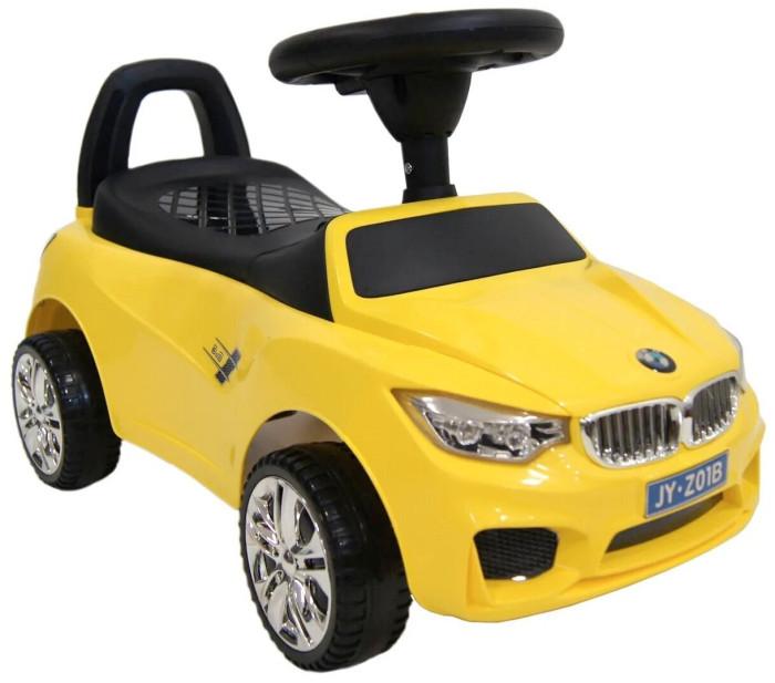 Каталка RiverToys BMW JY-Z01BBMW JY-Z01BКаталка RiverToys BMW JY-Z01B - это очень популярная и любимая многими детьми игрушка. Приводится в движение самим ребенком, путем отталкиваний ножками от пола.  С раннего возраста все детки мечтают о своём первом автомобиле! Толокар RiverToys BMW JY-Z01B - лучший подарок для малыша! Подходит для детей, которые уже научились сидеть самостоятельно. Широкие колёса и сиденье со спинкой обеспечивают комфорт, устойчивость и безопасность во время поездки. Машинка лёгкая и простая в управлении.  Особенности: Звуковые эффекты и световые эффекты Колеса: пластик Место для хранения Сиденье: пластик Устойчивые колеса с поворотом на 90 градусов Каталку можно везти перед собой  Специальное устройство не даст каталке перевернуться на ребёнка Максимальная допустимая нагрузка 20 кг Легкое движение вперёд и назад Для детишек, которые только начинают ходить каталку можно использоваться как ходунки, держась за спинку автомобиля.<br>