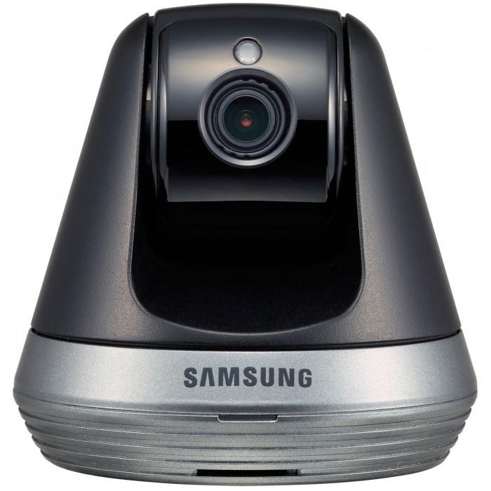 Samsung Wi-Fi видеоняня SmartCamWi-Fi видеоняня SmartCamSamsung Wi-Fi видеоняня SmartCam  Видеоняня от всемирно известной торговой марки Samsung. Оснащена всеми необходимыми функциями для комфортного и безопасного удалённого контроля за ребенком. Wi-Fi видеоняня непрерывно отслеживается звуки и движение в детской комнате. Если ваш малыш расплачется или, проснувшись начнёт двигаться, то видеоняня Samsung незамедлительно оповестит вас с помощью уведомления на смартфоне, планшете или персональном компьютере.  Видеоняня Samsung SmartCam SNH-V6410PN представляет из себя камеру, которая подключается к домашней сети Wi-Fi, а родительским блоком выступает ваш планшет, смартфон или компьютер. Наблюдать за ребенком можно не только дома, но и на любом удалении, используя интернет в вашем мобильном устройстве. Благодаря высокому качеству, которым славится продукция Samsung, видеоняня обеспечивает надёжный круглосуточный мониторинг детской комнаты.  Высокое качество потокового видео Full HD 1080p, обеспечивает детальное изображение в реалистичных цветах. При недостаточном освещении в детской комнате видеоняня автоматически переключается в режим ночного видения. Так что родители могут контролировать малыша днём и ночью, наслаждаясь высоким качеством изображения.  Особенности видеоняни Samsung SmartCam SNH-V6410PN:  Высокое качество изделия от всемирно-известного бренда. Стабильная и надёжная связь. Высокое качество изображения Full HD 1080p. Удалённое управление поворотом камеры с мобильного устройства. Наблюдение за ребёнком из любой точки планеты через интернет. В качестве родительского блока используется смартфон или планшет (iPad, iPhone, Android), ноутбук (Windows или MacBook) или настольный компьютер (Windows или Mac). Активация при обнаружении звука с уведомлением на родительское устройство. Активация при обнаружении движения с уведомлением на родительское устройство. Автоматический поворот камеры вслед за движением ребёнка. Возможно указать только определённую область ком