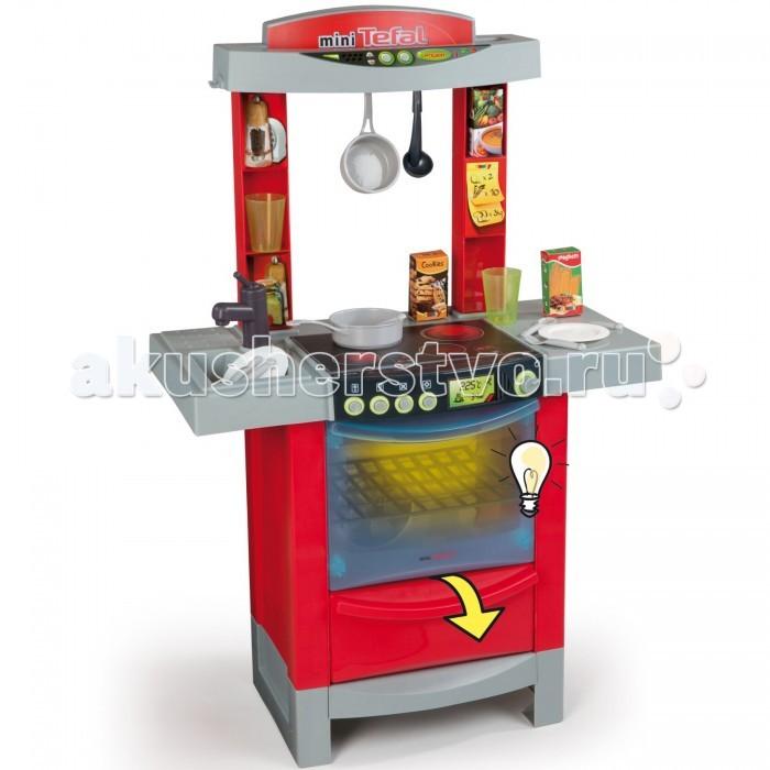 Smoby Кухня Tefal Cook TronicКухня Tefal Cook TronicЭлектронная игрушечная кухня Tefal Cook Tronic со световыми и звуковыми эффектами для сюжетно-ролевых игр детей в возрасте от 3 лет.  Кухня оснащена варочной панелью на 2 конфорки (газовая и электрическая), духовкой с открывающейся дверкой и подсветкой, раковиной с краном, разделочным столиком и полочками для хранения продуктов или посуды.  В наборе с кухней также есть 16 аксессуаров: 2 тарелки, 2 вилки, 2 ложки, 2 ножа, половник, 2 стакана, ковшик, сотейник, 3 упаковки с продуктами (не русифицированы).  При нажатии на кнопки включения конфорок загорается соответствующий индикатор, раздаются звуки приготовления пищи. Духовка открывается, открывается дверца внизу духовки. При открывании дверцы духовки загорается подсветка в духовке.  Тематические игровые наборы способствуют социальной адаптации ребенка, приобретению навыков, помимо того, что просто развлекают и доставляют массу удовольствия.  Размер: 56 х 29 х 86 см<br>