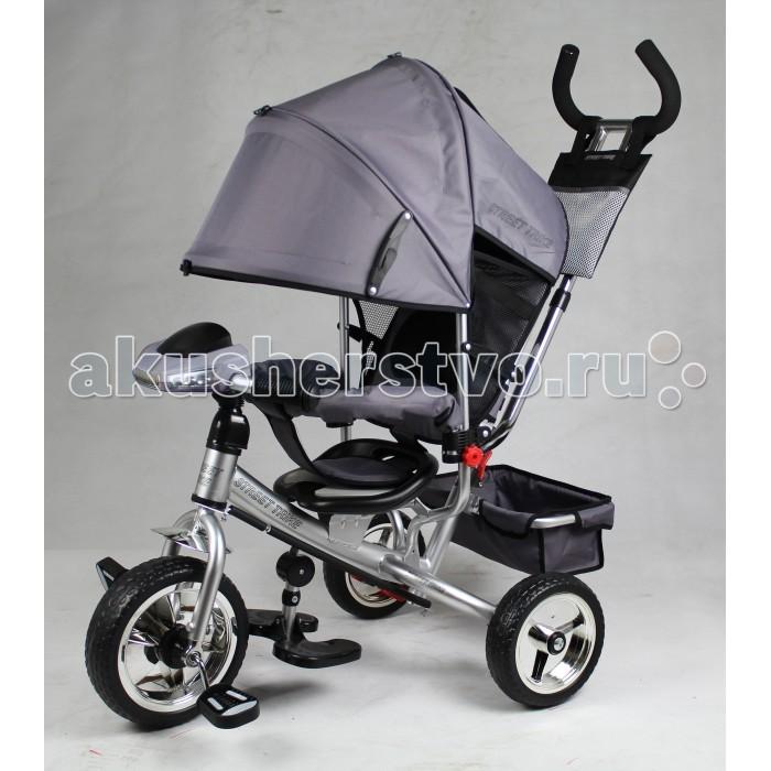 Велосипед трехколесный Street trike A22CA22CВелосипед трехколесный Street Trike A22C с ручкой толкателем и капюшоном.  Особенности: ручка управления движением позволяет родителям одной рукой контролировать поездку и управлять велосипедом защитный разъёмный поручень складывающиеся подножки колеса 10 и 8 дюймов складывающийся двух сегментный капюшон со смотровым окошком спинка с регулировкой угла наклона, 3 положения удобные не проскальзывающие педали из рифленого пластика металлическая хромированная ручка хромированные пластиковые диски эргономичное и удобное сиденье с мягкой тканевой подушкой две мягкие подушечки на спинке  возможность блокировки задних колеса тканевая багажная корзина для вещей и игрушек стильный звонок дополнительный кармашек, который крепится на ручке управления LED фара со встроенной музыкой колеса из мягкого ПВХ.<br>